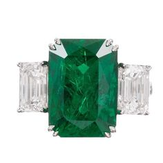 10.28 Carat Emerald Diamond Gold Ring | From a unique collection of vintage three-stone rings at https://www.1stdibs.com/jewelry/rings/three-stone-rings/