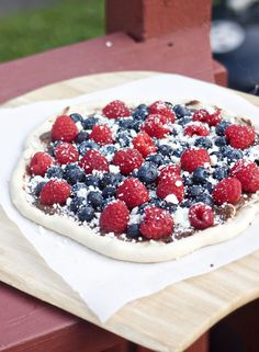 """Grilled Berry Pizza... fruit pizza complete with nutella sauce, berry toppings, and white chocolate """"cheese""""."""