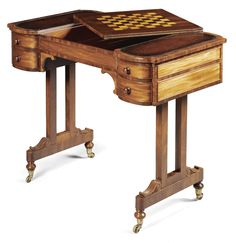 A late Regency mahogany combined writing and games tables circa 1820 the reversible central section of the top with an inlaid ebony and boxwood chess board, the well with an inlaid tric-trac or backgammon board, with four small drawers to each side