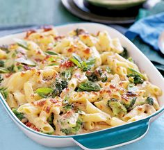 Creamy tuna & broccoli pasta bake. 200g dried penne 500g broccoli, cut into florets Cooking oil spray 2tbsp low-fat spread 50g plain flour 1 garlic clove, crushed Chilli flakes, to taste 500ml skimmed milk 2 x 200g tins tuna in spring water, drained and flaked 40g ready-to-eat sun-dried tomatoes, sliced 125g pack reduced-fat mozzarella, finely chopped Small bunch of fresh basil, to garnish 100g baby rocket