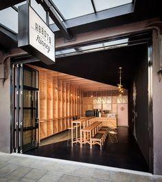 studio gram diagonally divides adelaide cafe into two