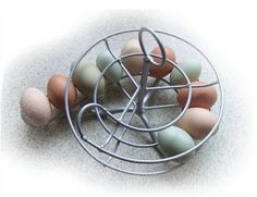[Photo of an egg skelter with white, brown, green and blue hens eggs, by V Gilmore]