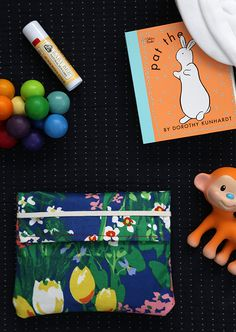 DIY: Create a stylish, waterproof diaper clutch to hold basic baby necessities.