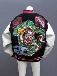 """Kansai Yamamoto (山本寛斎) embroidered dragon stadium jacket. This is a Kansai Man piece, believed to be early 1990s. Large single dragon and """"Kansai"""" kanji embroidery design on the back. More embroidered kanji on the front, white leather sleeves, and..."""
