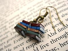 Love to read? Love someone who reads? Here is a perfect gift for the book-lover in your life (even if thats yourself)! These tiny earrings are made from polymer clay, and are hand painted to resemble a stack of books to dangle from each ear. Very cute for any bibliophile, librarian or author! They Book Lovers Gifts, Book Gifts, Order Book, Literary Gifts, Book Jewelry, Tiny Earrings, Stack Of Books, Bijoux Diy, Book Nerd