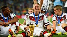 RIO DE JANEIRO, BRAZIL - JULY 13: Bastian Schweinsteiger of Germany celebrate with the World Cup trophy after the 2014 FIFA World Cup Brazil Final match between Germany and Argentina at Maracana on July 13, 2014 in Rio de Janeiro, Brazil. (Photo by Shaun Botterill - FIFA/FIFA via Getty Images)