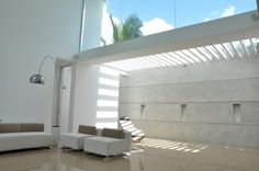 Beautiful Contemporary Modern Home Design in Sri Lanka: Cozy Patio With White Pergola, Glossy Floor, Modern Lamps, White Wall And Concrete Wall In Modern Residence ~ CLAFFISICA Architecture Inspiration