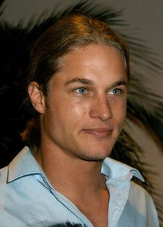 Pin for Later: If You Love Charlie Hunnam and Don't Know About Travis Fimmel, You're Missing Out You can't fault the guy for matching his shirt with his eyes.