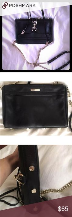 Rebeka minkoff black chain purse Hardly used. Good condition. Zips up and has two tassels. Well made. Goes with everything !! Rebecca Minkoff Bags Mini Bags