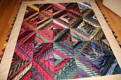 This quilt was a custom order made using my clients dads neckties. In this quilt I used about 40 ties and the quilt measured 87 x 75 including