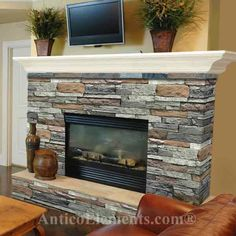 stacked stone fireplace but with a dark cherry wood mantle!
