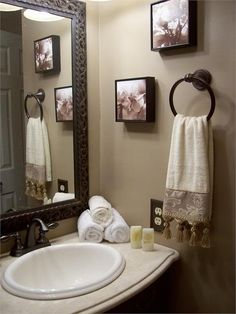 I love big mirrors in a bathroom. Want to trim my mirrors in wood like this.