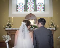 Bride and groom having a sneaky chat at the altar in Donaghmore Church, Co. Limerick