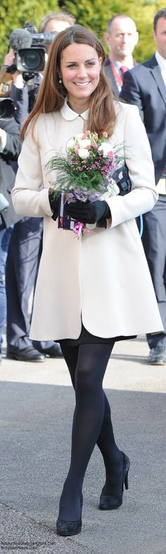 Catherine, Duchess of Cambridge carries flowers as she visits the offices of Child Bereavement UK on March 19, 2013 in Saunderton, Buckinghamshire.