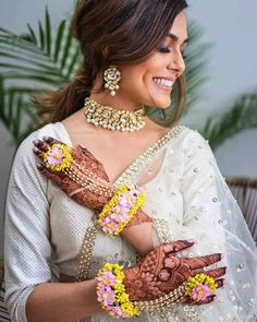 With artificial flowers and baby pearls Bridal Jewelry, Diy Jewelry, Haldi Ceremony, Baby Pearls, Golden Flower, Mini Roses, Flower Bracelet, Flower Jewelry, Mehandi Designs