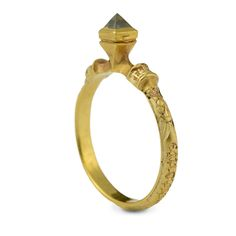 'AMOUR MI TIEN' (love grips me) English, circa 1430. Yellow gold , mounted with a full octahedral diamond crystal in a similarly shaped bezel raised from collars at the shoulders of the hoop.