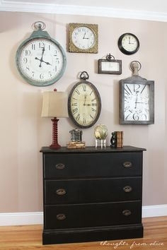 Clock Gallery Wall - I'd set the times to correspond with where I have friends and family around the world!