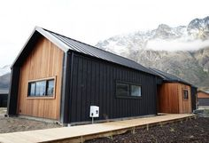 Cedar and Black Cladding Alpine Tray Roofing Wing Walled Gables Eco Home House Exterior #houseexteriorcolors #fachadasverdesarchitecture