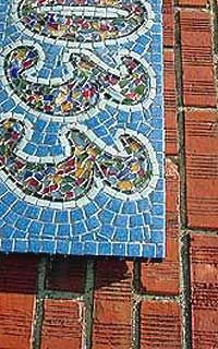 house number mosaic. I like the numbers in varied colors while the background is solid blue.