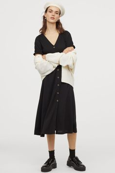 Calf-length dress in crinkled jersey with a V-neck decorative buttons at front and a seam at waist. Short sleeves and elasticized cuffs with ruffle trim. Polyester content is partly recycled. World Of Fashion, New Fashion, Style Personnel, Calf Length Dress, Powder Pink, Crinkles, Fashion Company, Fashion Addict, Neue Trends
