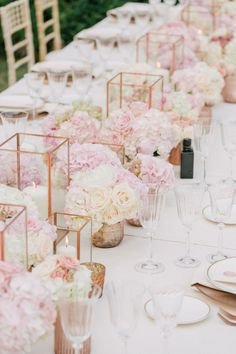 Copper Candle Holders & Pink Flowers  Photography: Maitha Lunde Read More: http://www.insideweddings.com/weddings/beautiful-alfresco-destination-wedding-in-the-south-of-france/1039/