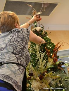 How to decorate a Christmas tree via Worthing Court blog -Choose three more slightly shorter and more full picks.  Place these a few inches closer to the top and in between the spaces of the first layer, also at an upward angle.