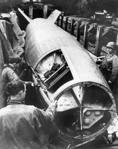 American soldiers inspect a V-2 rocket captured intact in April 1945. The...