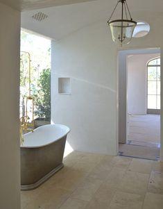 Platinum Slipper Tub, travertine floor