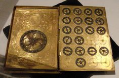 File:16th century French cypher machine in the shape of a book with arms of Henri II.jpg