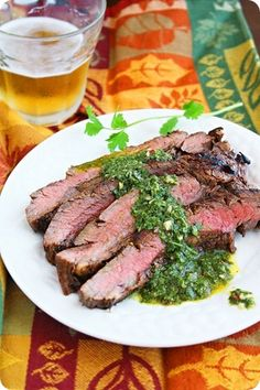 Grilled Marinated Flank Steak with Chimichurri Sauce  http://www.thecomfortofcooking.com/2012/05/grilled-marinated-flank-steak-with.html