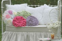 Lovely vintage day bed in the garden. Love these ruffled pillows and the lace.