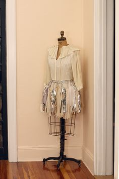mannequin ::what about placing fabric over then draping jewelry and adding the pins
