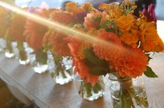 Orange flowers in cute jars...for centerpieces for the shower??...put in the mason jars with a cute ribbon around?