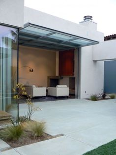 An up-and-over garage door can be used as a wall, window, and when it is it is flipped out and overhead, it becomes a patio roof.