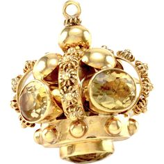 Vintage citrine crown orb pendant set in 14K yellow gold. There are five oval and round faceted citrine (7.81ctw) that are bezel set in high polish