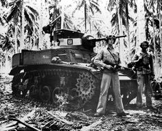 Two alert U. Marines stand beside their small tank on Guadalcanal in the Solomon Islands during World War II. The military tank was used against the Japanese in the battle of the Tenaru River during the early stages of fighting. War Of The Pacific, South Pacific, World Of Tanks, Us Marines, Korean War, War Machine, Military History, World War Two, Dieselpunk