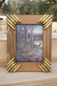 Handmade brass bullet picture frame. 8x10 frame for a 5x7 picture. Deer picture included but would be great for your favorite hunting picture. Frame is all wooden and handmade.
