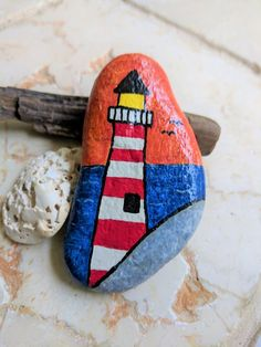 Painted Rocks, Beach Stones, Paperweight, Gifts under Plant Marker, Collectible - Lighthouse - Products - paintter Pebble Painting, Pebble Art, Stone Painting, Rock Painting Ideas Easy, Rock Painting Designs, Lighthouse Painting, Painted Rocks Kids, Plant Markers, Kindness Rocks