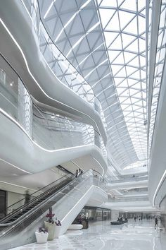 Interior view of a shopping centre covered in silver balls by UNStudio