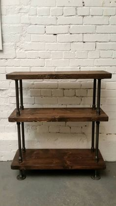 Rustic wood shelves with industrial pipe mount Rustic Bookcase, Wood Bookshelves, Wood Shelves, Bookshelf Bar, Diy Shelving, Storage Shelves, Rustic Industrial Furniture, Industrial Living, Rustic Wood