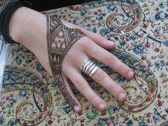 african henna design on hand