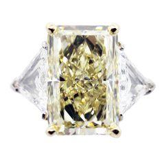 12.02 Fancy Yellow Internally Flawless Diamond set with two Trillian Cut Diamonds 3.50ctw Platinum and 18k