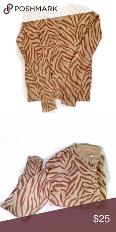 Brown zebra printed cardigan Lovely old many tan and brown printed zebra cardigan. Super soft and cozy. Condition is used with some wear and pilling. Please ask any questions prior to purchase. Old Navy Sweaters Cardigans