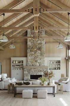The stone fireplace makes a statement in this open plan living space. We love the barn interior style