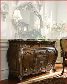 """AICO Sideboard Palais Royale AI-71007 by AICO. $2099.00. AICO Dining Set Palais Royale. The Palais Royale® collection is reminiscent of the elaborate detailing of the classic French Rococo styling with its intricate veneer work, undulating curves and exuberant floral embellishments. French Rococo came to creation during the late 17th and late 18th centuries, with the word originating from a combination of the French word """"rocaille,"""" or shell, and the Italian """"barocco..."""
