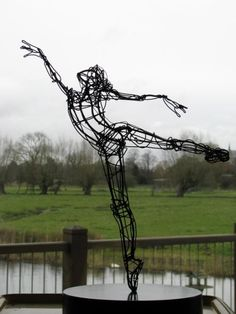 Ballerina pointing up - Sculptures by Martin Wright