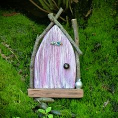 It\'s been so dry that most of the moss in my garden is looking pretty brown, but the patch by the waterfall is always green! #smallhavens #fairydoor #pinkdoor #pauashell #greenmoss #fairytale #fairies #pixies #fairygardening #ibelieveinfairies #etsyau #supporthandmade