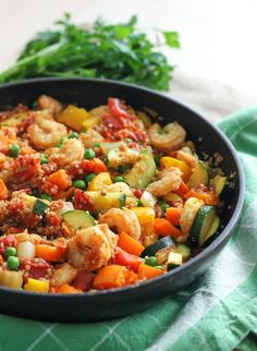 Shrimp and Quinoa Paella - an easy, high-protein dinner that's gluten-free and full of whole foods. This one will leave you feeling well-nourished and completely satisfied! Recipe via Eat Spin Run Repeat // Best Quinoa Recipes, Veggie Recipes, Seafood Recipes, Healthy Dinner Recipes, Veggie Meals, Healthy Meals, Easy Fish Recipes, Clean Eating Recipes, Free Recipes