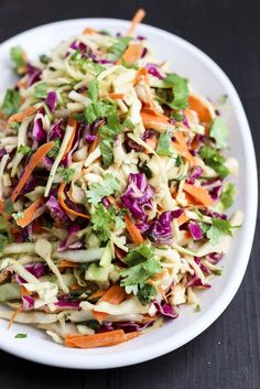 Ginger Asian coleslaw is packed with fresh flavors like ginger, peanut butter & cilantro! It's delicious as a side dish or to top sandwiches and wraps! Ginger Asian coleslaw to go on top of Pineapple vegan pulled jackfruit (pork). Keto Foods, Vegan Keto Recipes, Slaw Recipes, Vegan Dinner Recipes, Vegan Dinners, Cooking Recipes, Healthy Recipes, Vegan Potluck, Potluck Recipes
