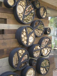 I ADORE THIS - Lovely insect hotel wall installation - RBC Blue Water Roof Garden by Professor Nigel Dunnett Would make fabulous garden art feature as well and encourage insects into the garden :)